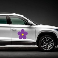 Printed Purple Daisy Flower Magnet on a Car Side example
