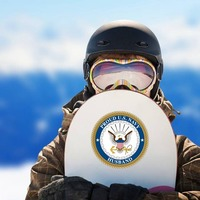 Proud US Navy Husband Sticker on a Snowboard example