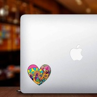 Psychedelic Heart Shaped Hippie Sticker on a Laptop example
