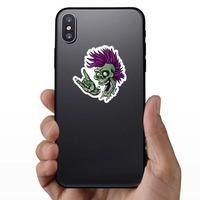 Punk Rock Cartoon Skull Sticker on a Phone example