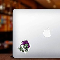 Punk Rock Cartoon Skull Sticker on a Laptop example