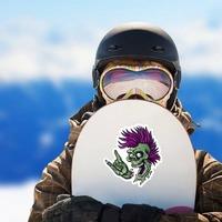 Punk Rock Cartoon Skull Sticker on a Snowboard example