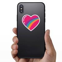 Rainbow Heart Hippie Sticker on a Phone example