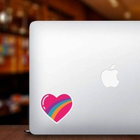 Rainbow Heart Hippie Sticker on a Laptop example
