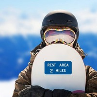 Rest Area 2 Miles Sticker on a Snowboard example