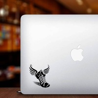 Running Track Shoe with Wings Sticker on a Laptop example