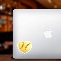 Shiny Yellow Heart Softball Sticker on a Laptop example