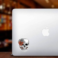 Skull With Side Bow Of Flowers Sticker on a Laptop example