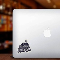 The Mountains Are Calling Sticker on a Laptop example