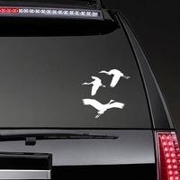 Three Cranes Flying Sticker on a Rear Car Window example