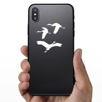 Three Cranes Flying Sticker on a Phone example