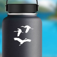 Three Cranes Flying Sticker on a Water Bottle example