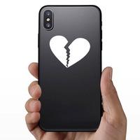 Unhappy Broken Heart Sticker on a Phone example