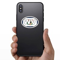West Virginia Wv State Flag Oval Sticker on a Phone example