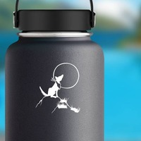 Wolf Coyote Howling At The Moon Sticker on a Water Bottle example